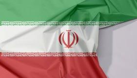 Iran tkaniny flaga zagniecenie z biel przestrzenią i krepa obrazy royalty free