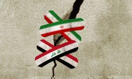 Iran- und Irak-Verbände über Sprung auf Wand Stockfotografie