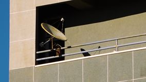 Iranian�s embrace satellite dishes. Still shot shows the popularity of satellite dishes on the side of colourful apartment block in Tabriz, Iran stock footage