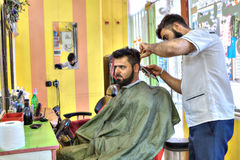 Iranian Barber salon, Persian hairdresser makes hair style for m Royalty Free Stock Image