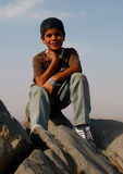 Iranian boy. Young boy, on a rock at Mashad, Iran Royalty Free Stock Images
