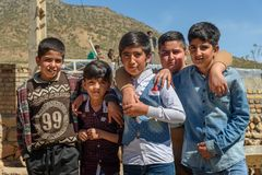 Iranian boys on wedding ceremony in the village. Lorestan Province. Iran. Lorestan Province, Iran - April 1, 2018: Iranian young boys on wedding ceremony in the royalty free stock photo