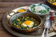 Iranian breakfast made with eggs, bean and dill. Served with bread and rice Stock Photography