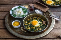 Iranian breakfast made with eggs, bean and dill. Served with bread and rice Royalty Free Stock Image