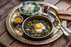 Iranian breakfast made with eggs, bean and dill. Served with bread and rice Stock Images