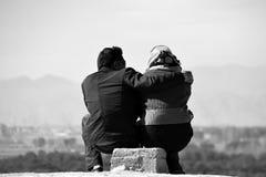Iranian couple. A young Iranian couple enjoying the views of Persepolis Stock Images
