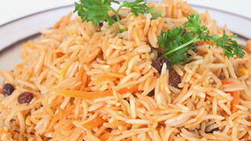 Iranian Cuisine: Yellow Rice with Raisins and carrots stock footage