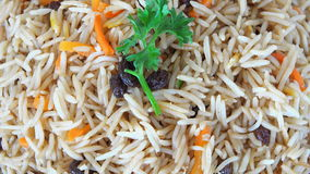 Iranian Cuisine: Yellow Rice with Raisins and carrots stock video footage