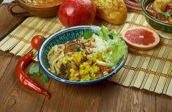 Iranian Zereshk Polo Morgh. Iranian cuisine - Zereshk Polo Morgh,Persian classic made chicken and Persian rice Royalty Free Stock Photo