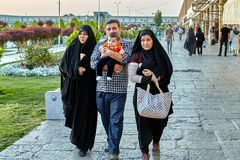 Iranian family walks around Naghshe Jahan Square in Isfahan, Ira Stock Photography
