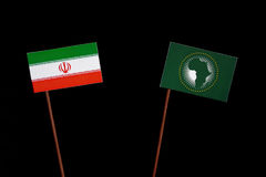 Iranian flag with African Union flag isolated on black. Background Royalty Free Stock Image