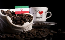 Iranian flag in a bag with coffee beans  on black. Background Stock Photo