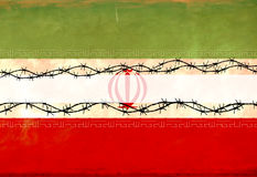 Iranian Flag. An Iranian flag with barb wire fence Royalty Free Stock Photo