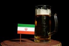 Iranian flag with beer mug isolated on black Stock Image
