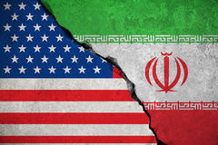 Iranian flag on broken wall and half usa united states of america flag, crisis trump president and iran for nuclear atomic risk w. Ar concept stock photo