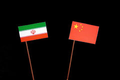 Iranian flag with Chinese flag isolated on black. Background Royalty Free Stock Photo