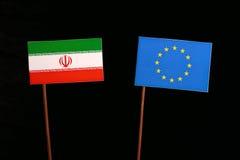 Iranian flag with European Union EU flag  on black. Background Stock Photos