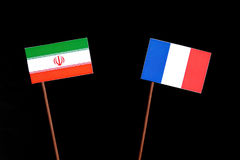Iranian flag with French flag isolated on black. Background Stock Image
