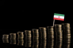 Iranian flag with lot of coins  on black Royalty Free Stock Photos