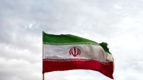 Iranian Flag is Seen Flying in the Wind in Slow Motion.  stock video