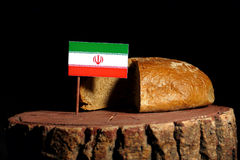 Iranian flag on a stump with bread. Isolated Royalty Free Stock Image