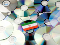 Iranian flag on top of CD and DVD pile isolated on white. Iranian flag on top of CD and DVD pile isolated Stock Photos