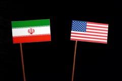 Iranian flag with USA flag isolated on black Stock Photos