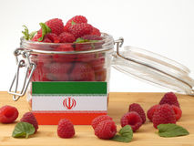 Iranian flag on a wooden panel with raspberries isolated on a wh Royalty Free Stock Image
