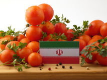 Iranian flag on a wooden panel with tomatoes isolated on a white. Background Stock Images