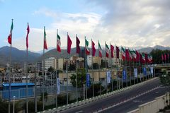 Iranian flags with snow-capped mountains in the background, Tehran, Iran stock image