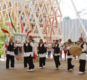Iranian folklore dancers are dancing with passion in front of the Iran pavilion at EXPO Milano 2015. royalty free stock image