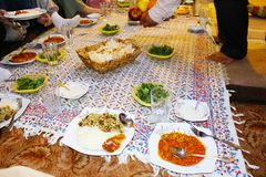 Table set for a typical Iranian dinner in Shiraz, Iran royalty free stock photo
