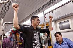 Iranian man holding railings in the underground, Tehran, Iran. Stock Image