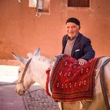 Iranian man and white pony Stock Photos