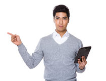 Iranian mixed chinese businessman hold with tablet and finger up Stock Photos