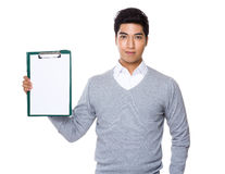 Iranian mixed chinese businessman showing with the file board Stock Photos