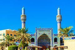 Iranian Mosque on the city street, Dubai, United Arab Emirates. Isolated on blue background.  stock images