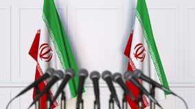Iranian official press conference. Flags of Iran and microphones. Conceptual 3D rendering. Iranian official press conference. Flags of Iran and microphones Royalty Free Stock Image