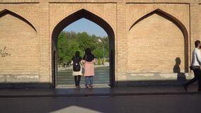 Iranian people on SioSePol or Bridge of 33 arches, Isfahan, Iran stock video footage