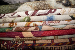 Persian Carpet. Iranian and persian carpet on the shelf of shop for sale Royalty Free Stock Image