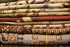 Carpet. Iranian and persian carpet on the shelf of shop for sale Stock Image