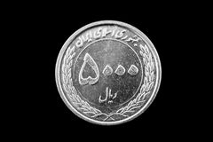 Iranian 5000 Rial coin on black stock photos