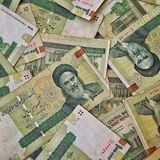 Iranian rial. Pile of 100000 rial banknotes, Iranian currency Royalty Free Stock Images