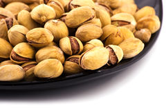 Iranian salted pistachio. In dark plate Stock Photo