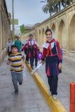 Iranian schoolgirl in uniform goes home after school. Royalty Free Stock Photo