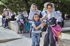 Iranian schoolgirls in school uniform for walk around city, Shiraz. stock photography