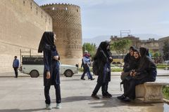 Iranian schoolgirls waiting to start tour in Karim Khan citadel. royalty free stock images