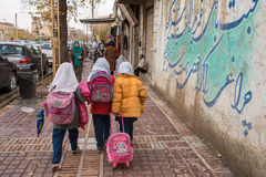 Iranian schoolgirls walk on the streets of Shiraz city, Iran Stock Images