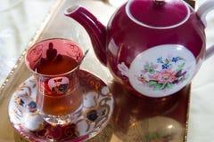 An Iranian tea set. An Iranian tea cup, saucer and teapot with sugared almonds stock photography
