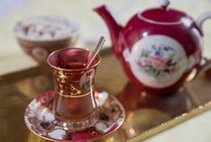 An Iranian tea set. An Iranian tea cup, saucer and teapot with sugared almonds royalty free stock image